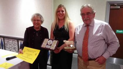 Lousie receiving the trophy on behalf of the Eden Flock